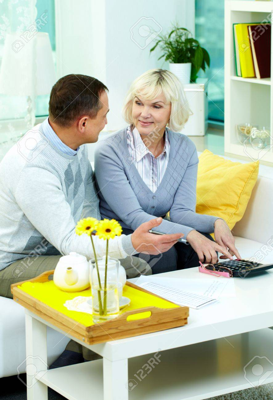 Portrait of mature man and his wife planning family budget at home Stock Photo - 12328591