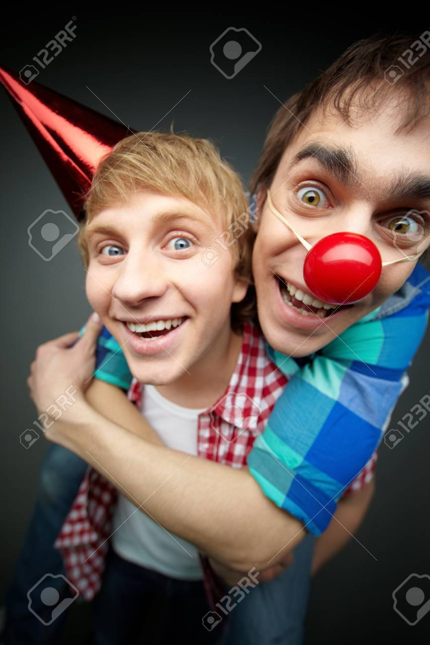 Guy holding his friend piggyback at a fool�s day party Stock Photo - 12380936