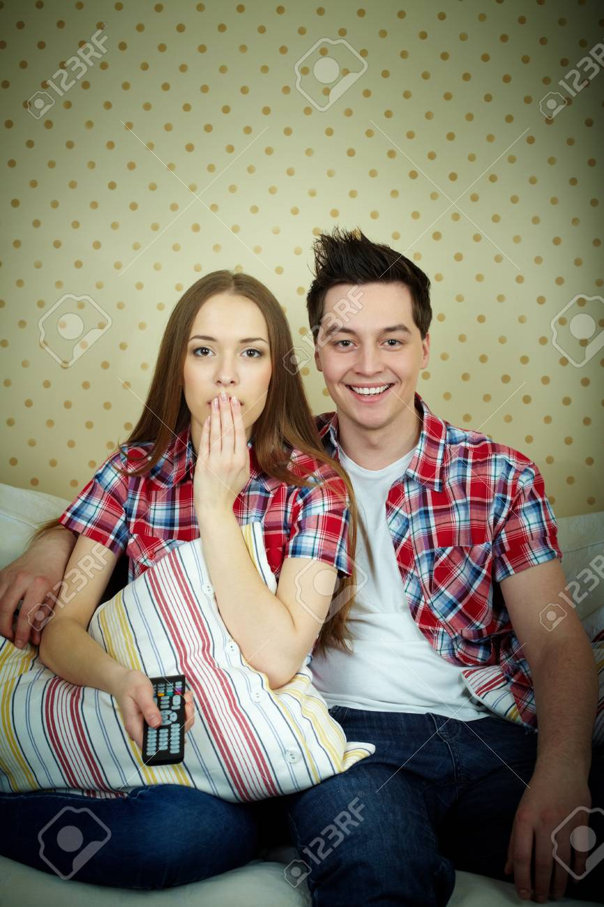 Portrait of young couple during watching TV Stock Photo - 12872985