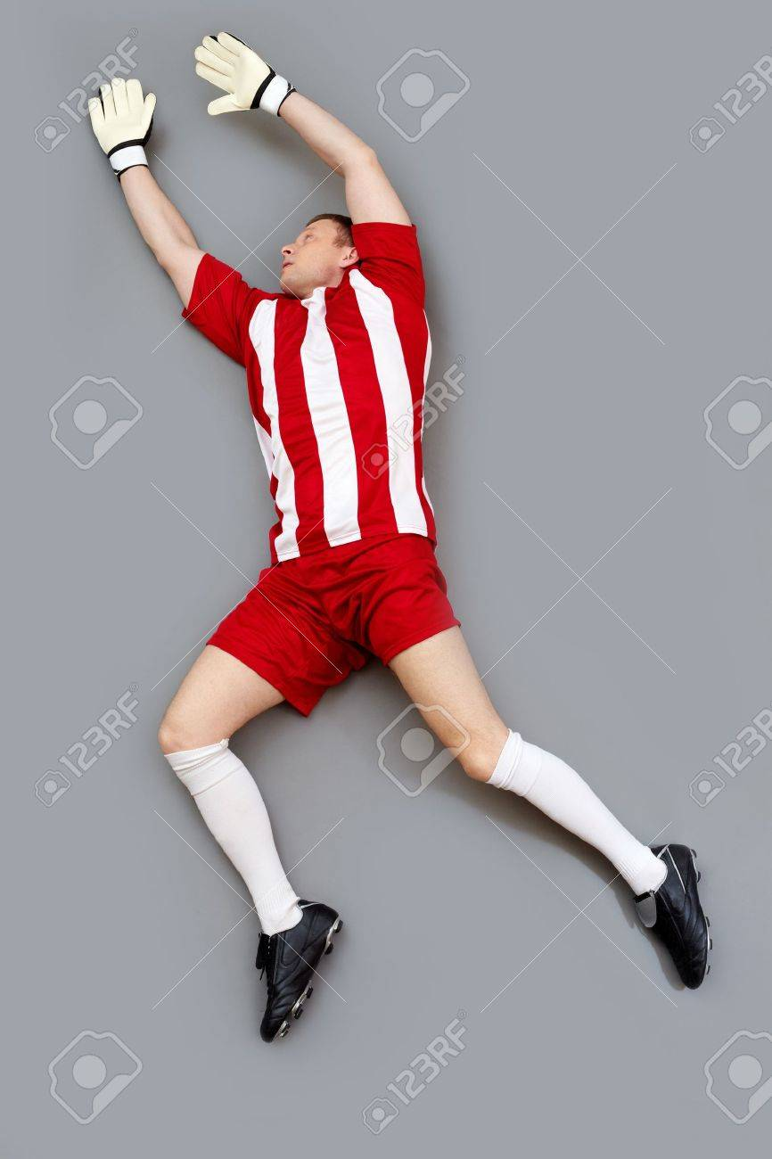 Goalkeeper jumping high to catch the ball Stock Photo - 13119354