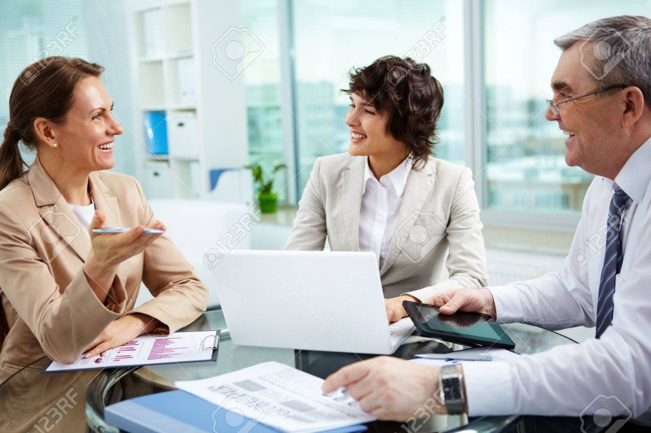 Female leader talking to her workgroup about a new profitable idea Stock Photo - 13119113