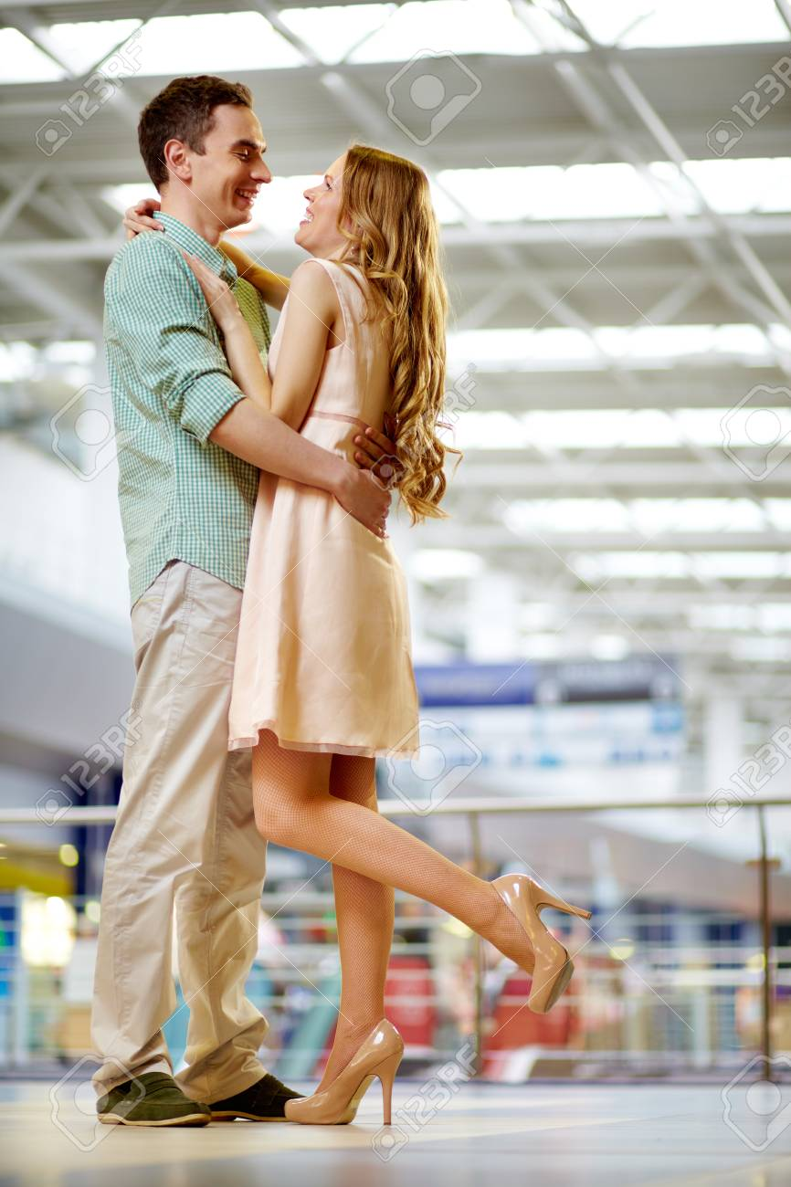 A young woman and her boyfriend embracing and laughing Stock Photo - 13119074