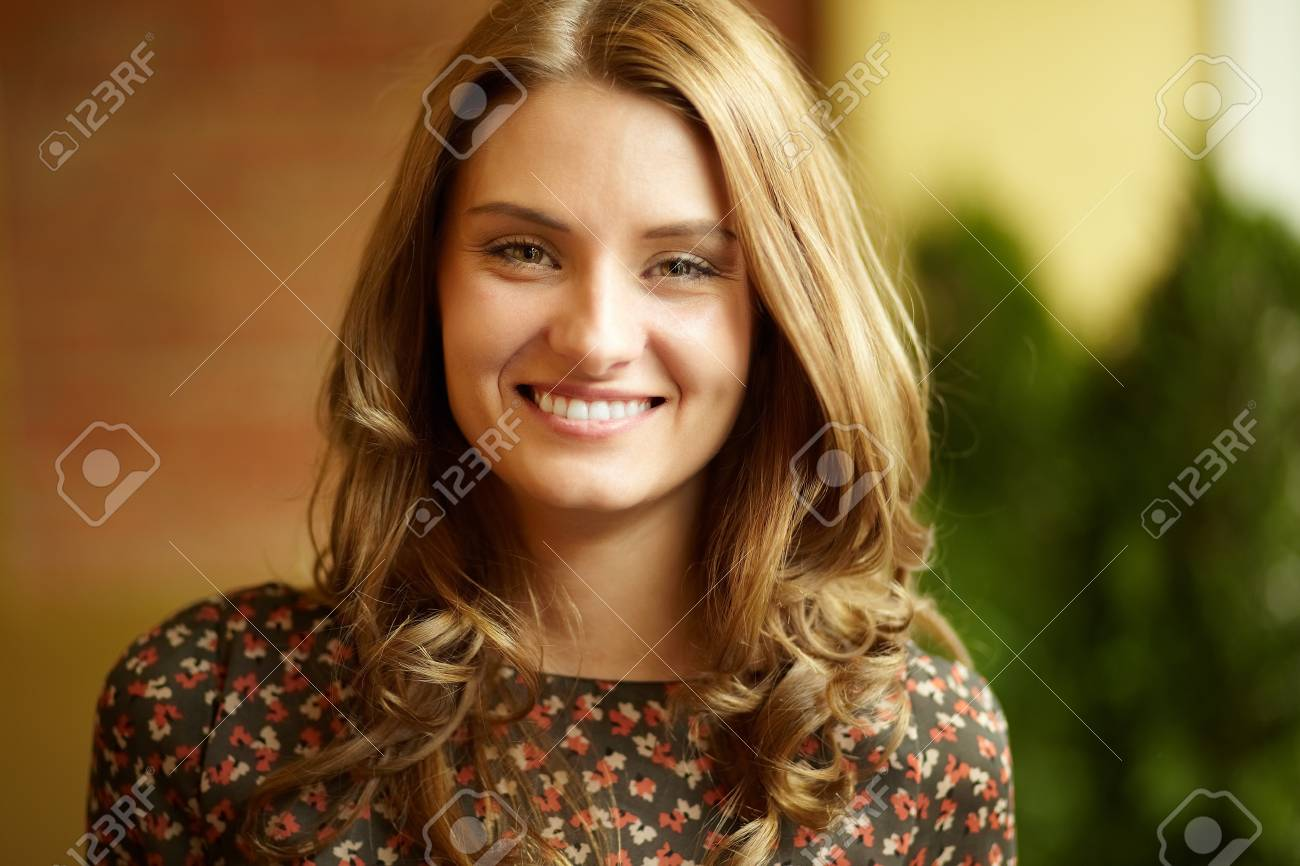 Image of young woman looking at camera with smile Stock Photo - 13301940