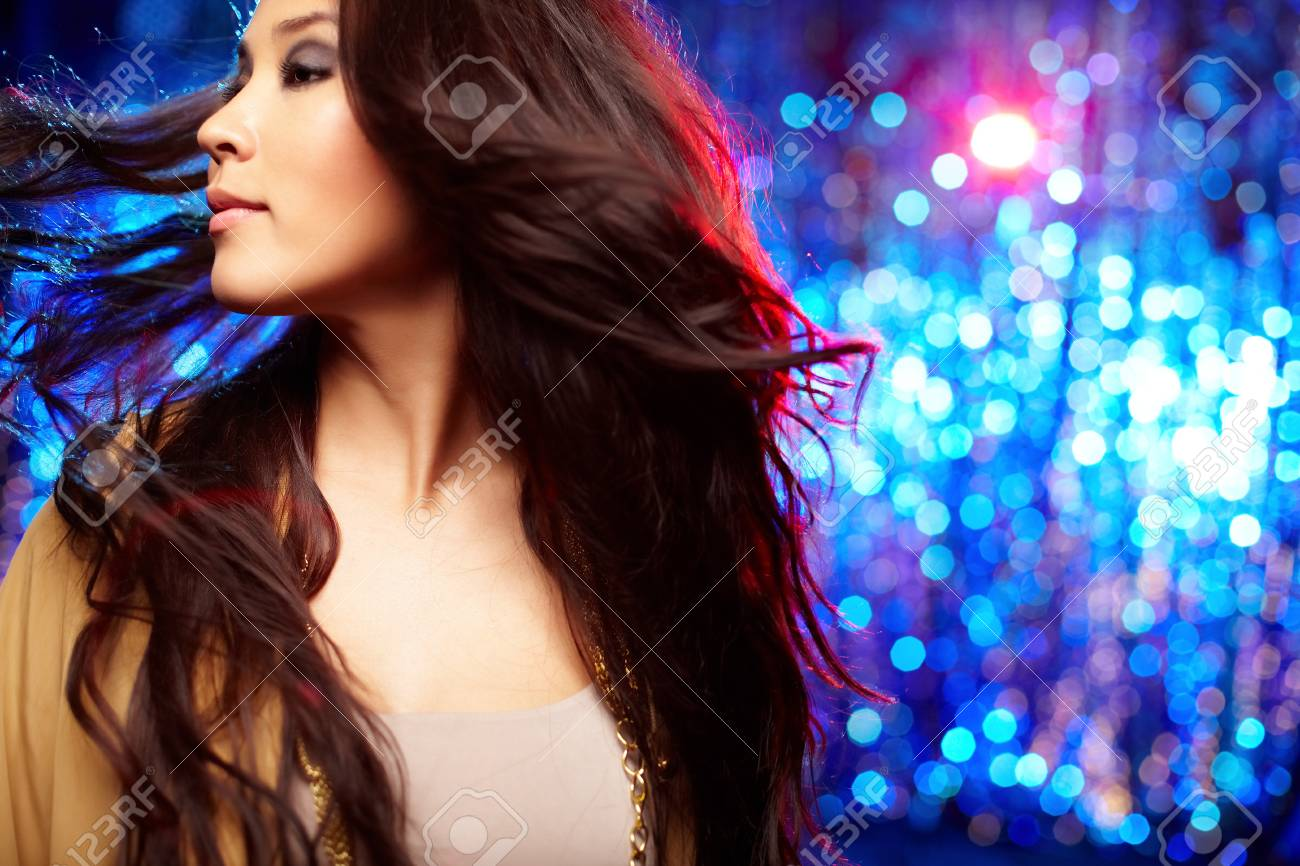 Portrait of a gorgeous young woman shot in motion against sparkling background Stock Photo - 13302056