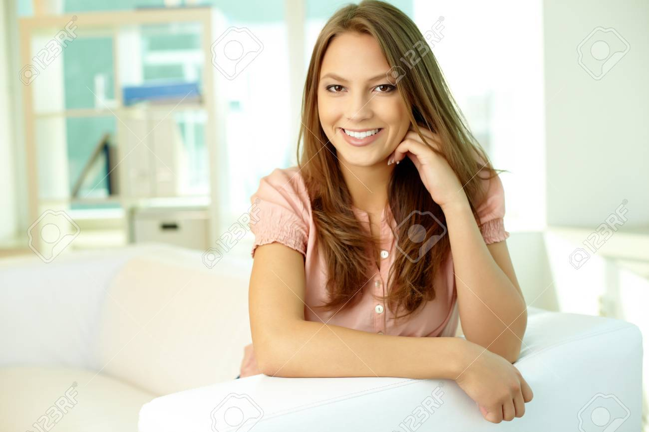 Portrait of a pretty brunette smiling and posing in front of the camera Stock Photo - 13313500