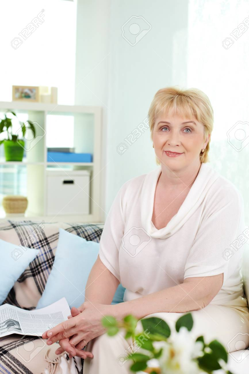 Portrait of friendly aged woman looking at camera at home Stock Photo - 13631159
