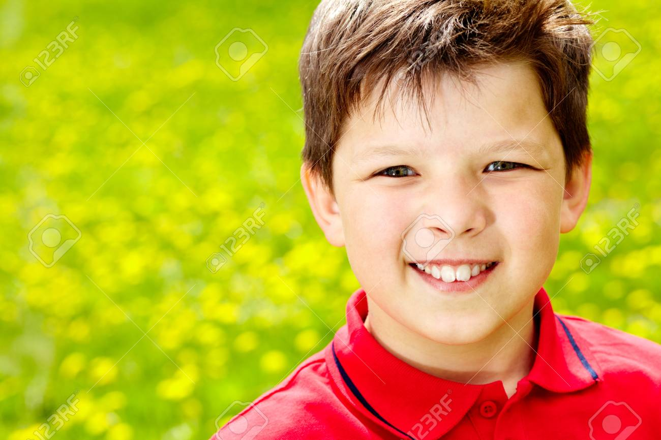 Close-up portrait of happy boy outside Stock Photo - 13767230