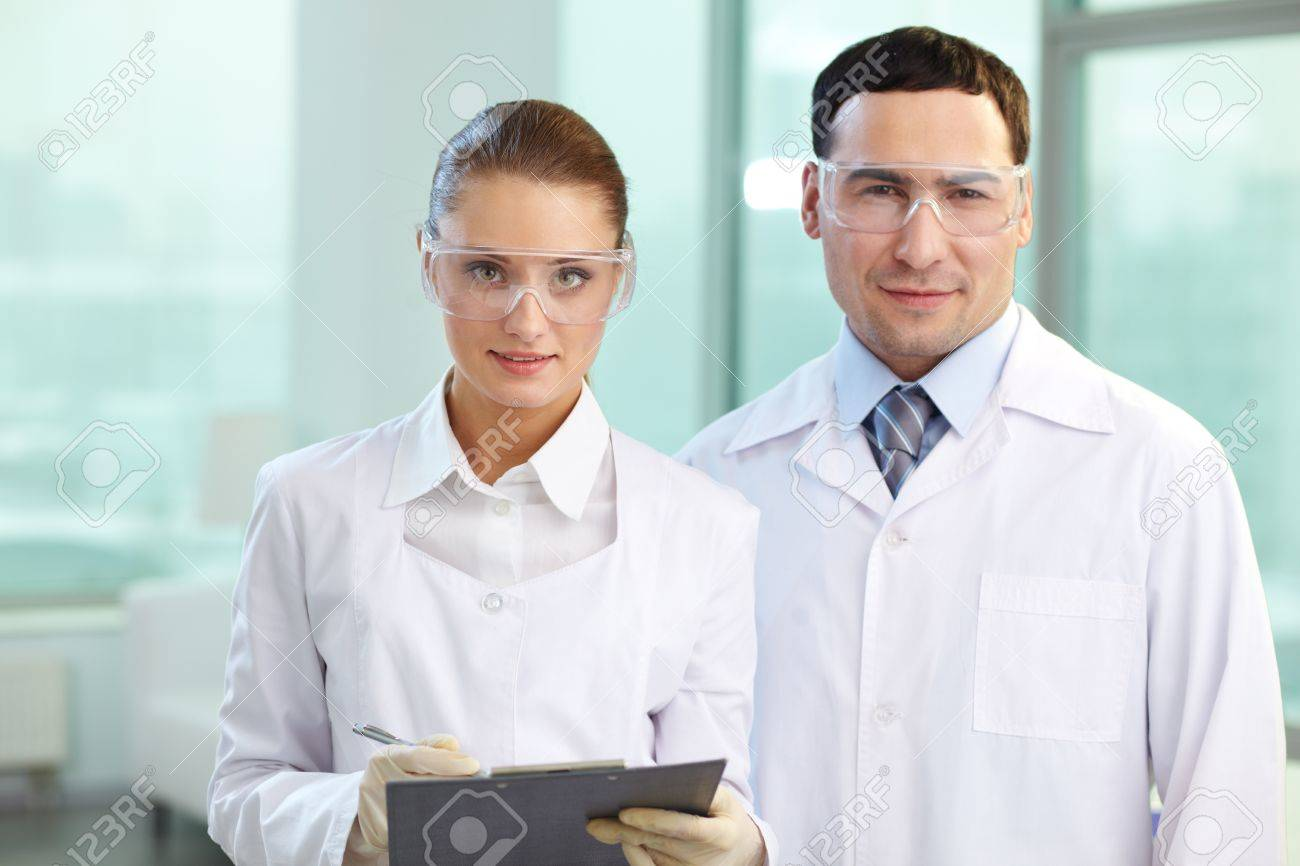 Portrait of two scientists looking at camera and smiling Stock Photo - 13857144