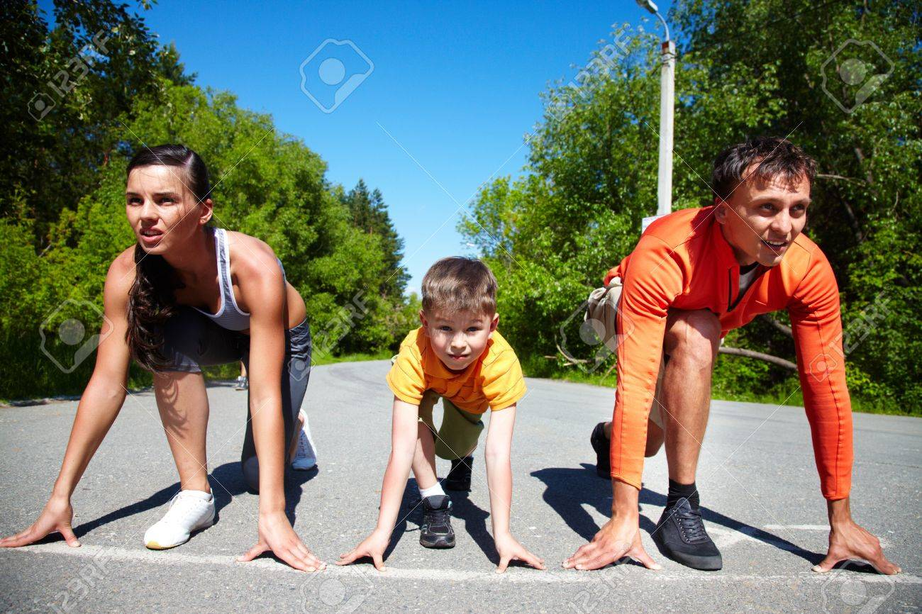 Portrait of family of three standing on start before running Stock Photo - 13949806