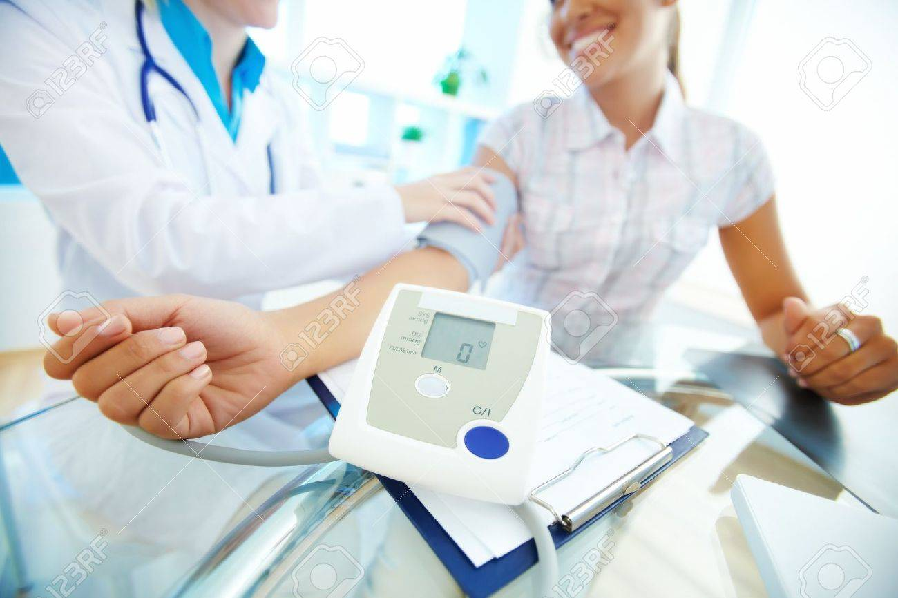 Close-up of tonometer by patient�s arm during blood pressure measuring at medical consultation Stock Photo - 14843597