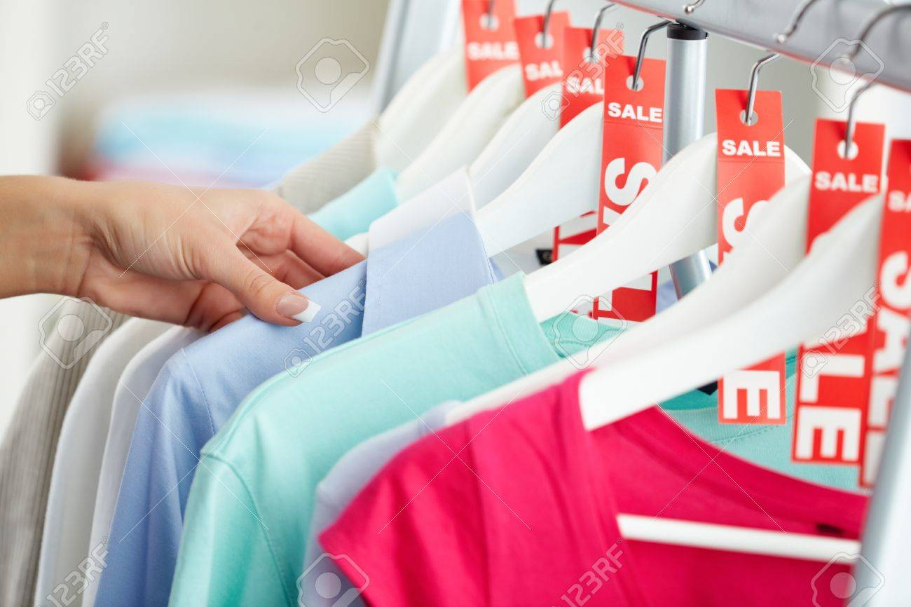 Photo of human hand searching through hangers with clothes Stock Photo - 14917737