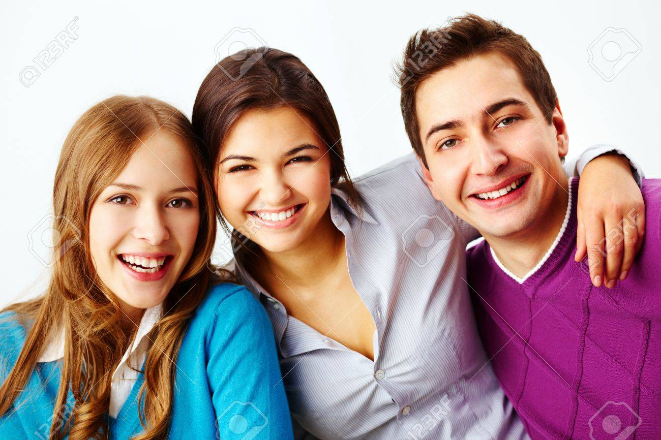 Portrait of attractive friends looking at camera and smiling Stock Photo - 15104290