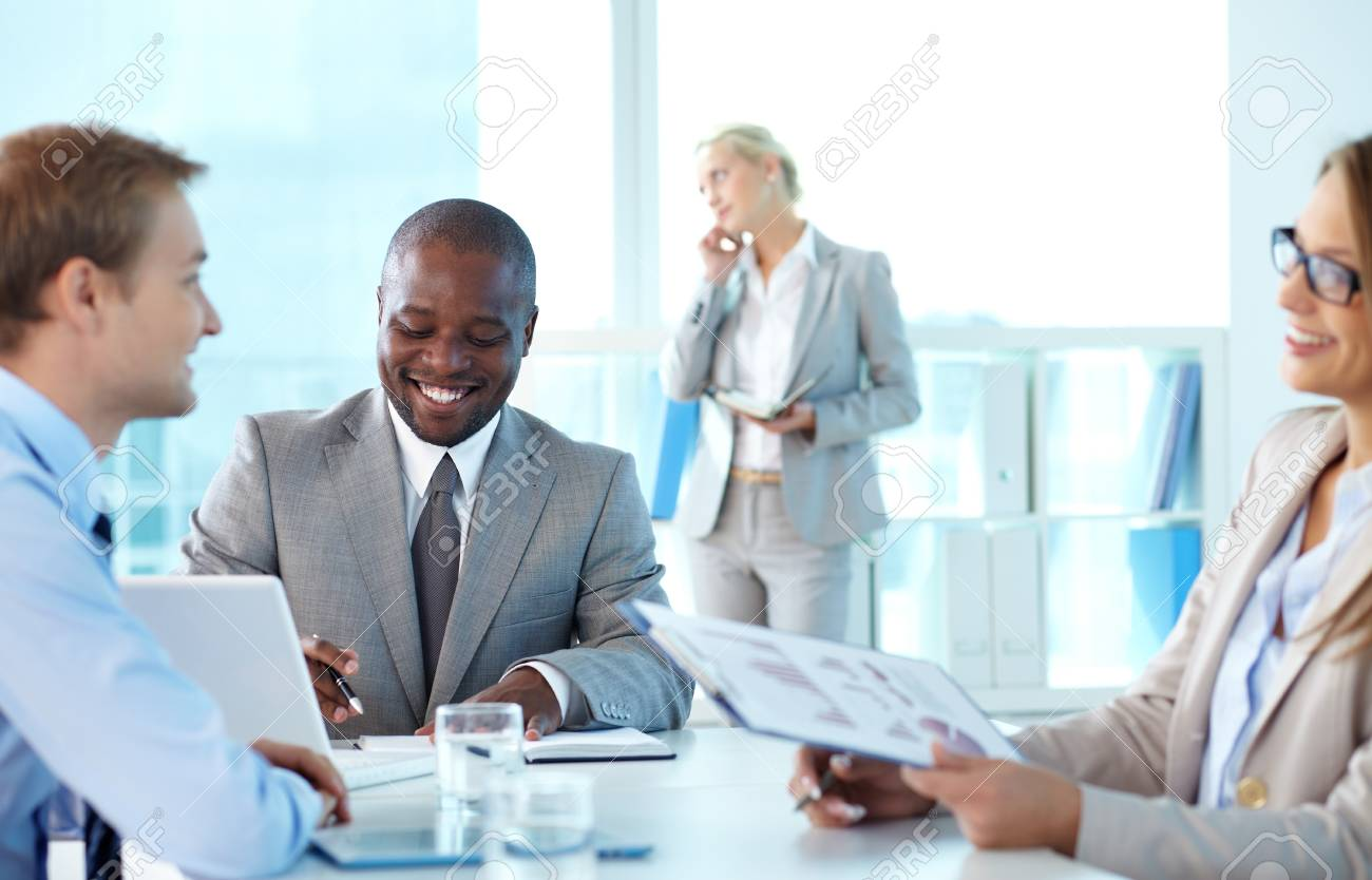Portrait of confident boss smiling while his partners interacting at meeting Stock Photo - 15315948