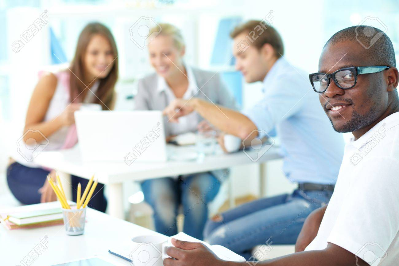 Portrait of happy African guy looking at camera in working environment Stock Photo - 15436182