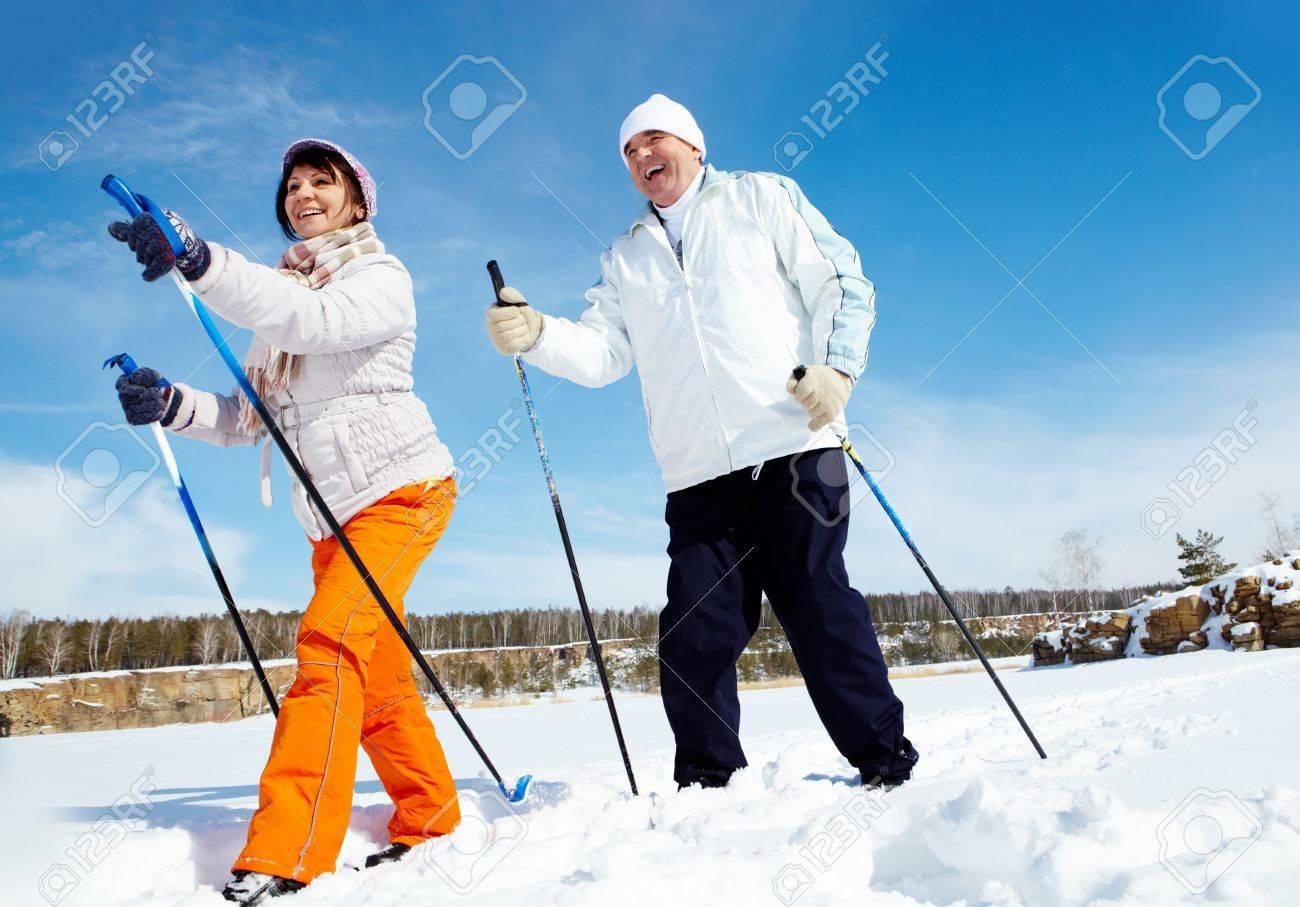 Portrait of mature couple skiing outside - 15436473