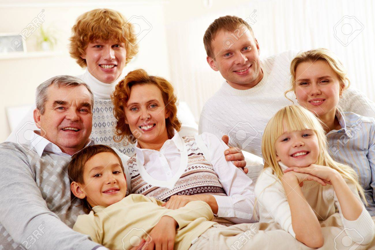 Portrait of senior and young couples with their children relaxing at home Stock Photo - 15610039