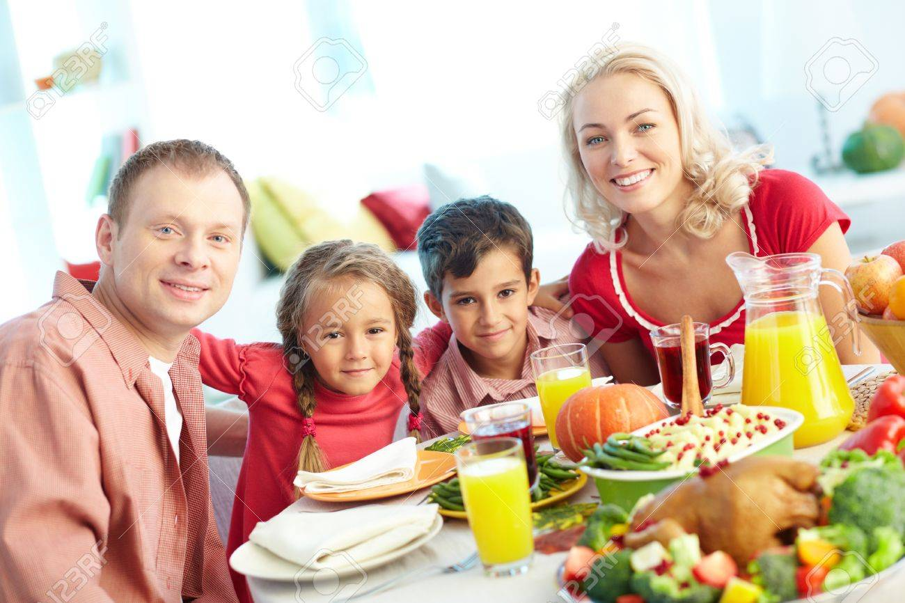 Portrait of happy family sitting at festive table and looking at camera Stock Photo - 15610056