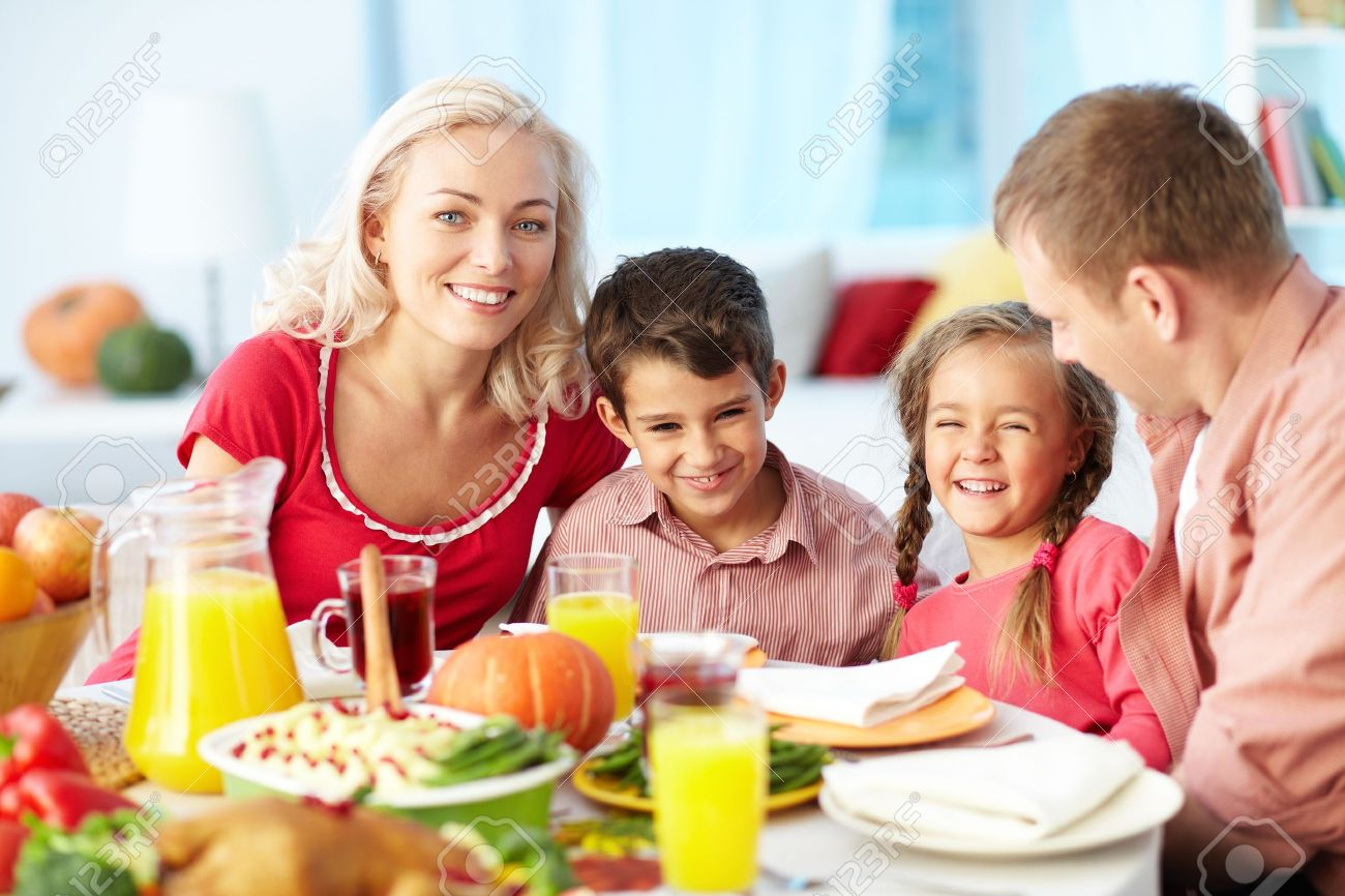 Portrait of happy family gathered at festive table on Thanksgiving Day Stock Photo - 15610903