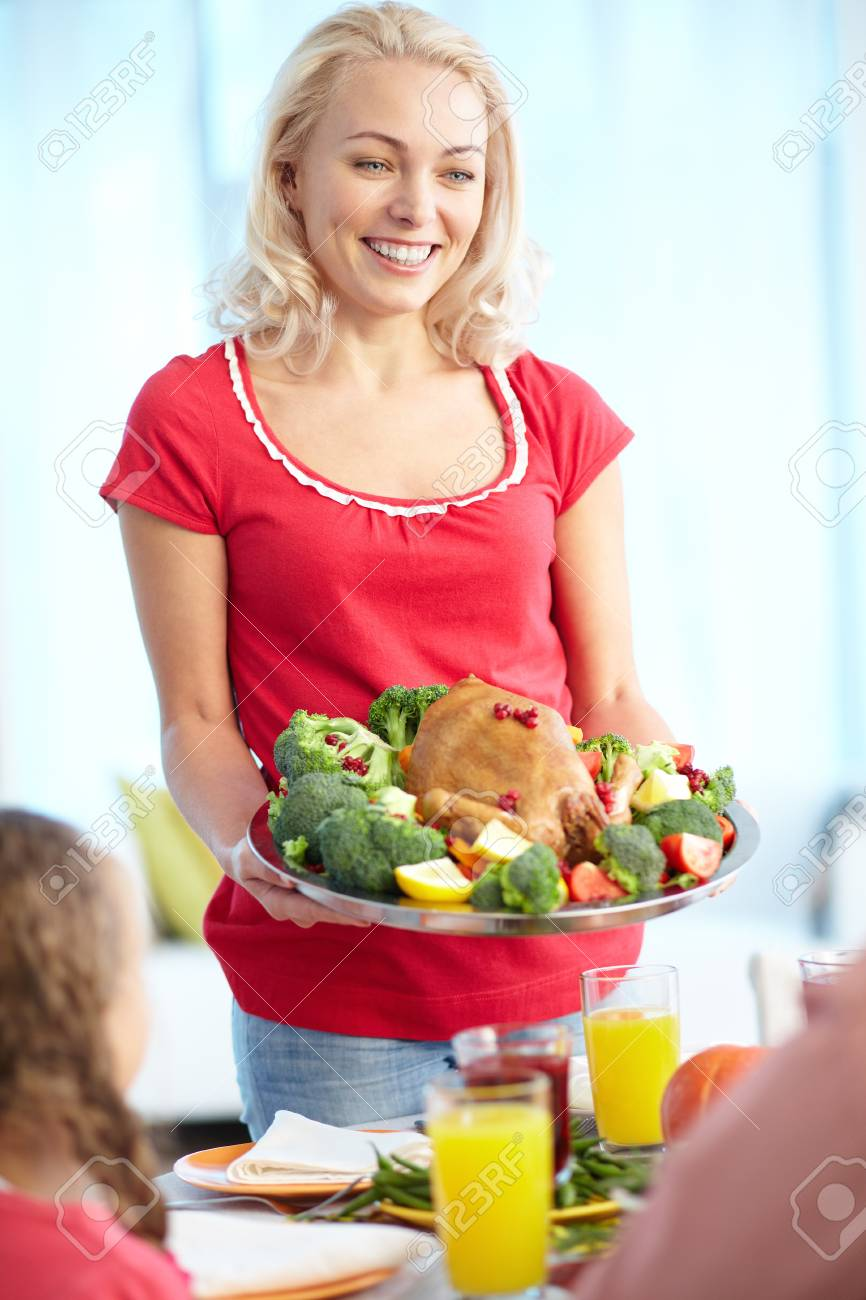 Portrait of pretty woman with roasted turkey going to put it on festive table Stock Photo - 15610643