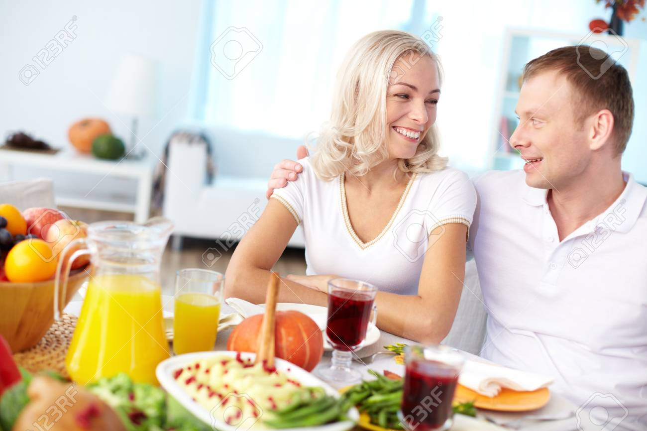 Portrait of happy couple sitting at festive table and looking at one another Stock Photo - 15607218