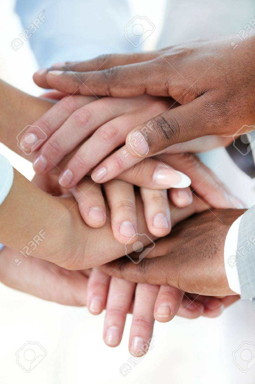 Vertical image of pile of hands of business partners Stock Photo - 16103616
