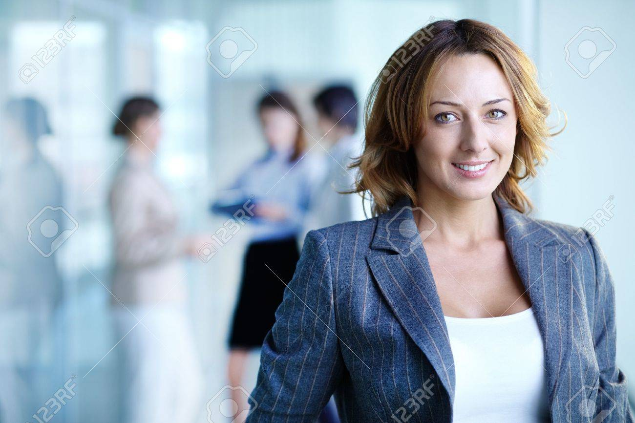 Image of pretty businesswoman looking at camera - 16085683