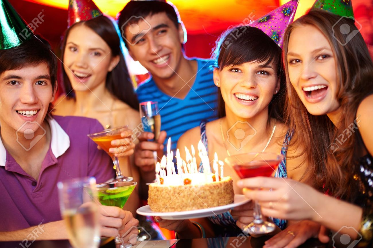 Portrait of joyful friends toasting and looking at camera at birthday party Stock Photo - 16304934