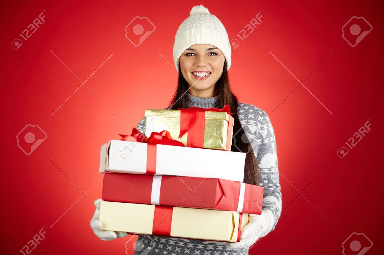 Portrait of happy girl with stack of giftboxes looking at camera Stock Photo - 16221830