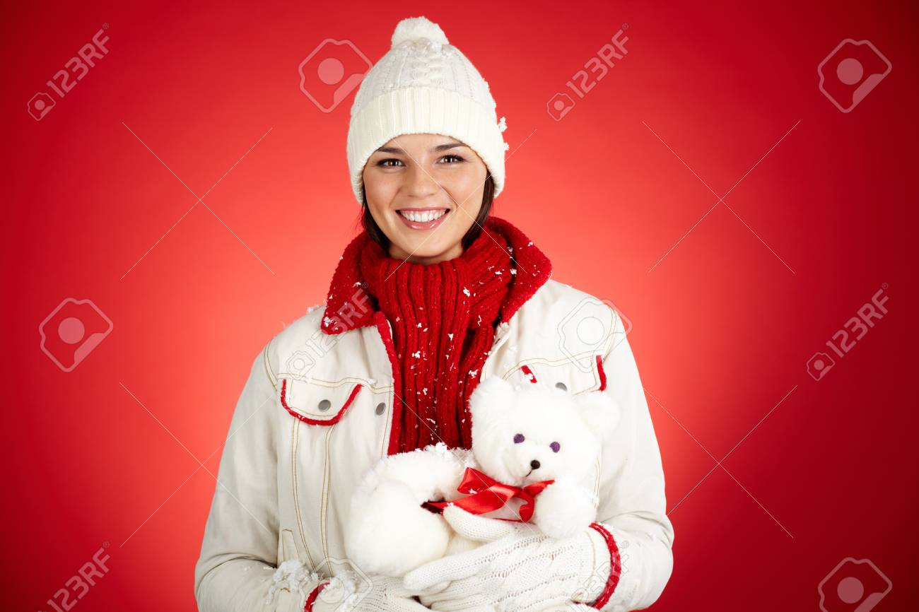 Portrait of happy girl in winterwear holding white teddy bear and looking at camera Stock Photo - 16221832