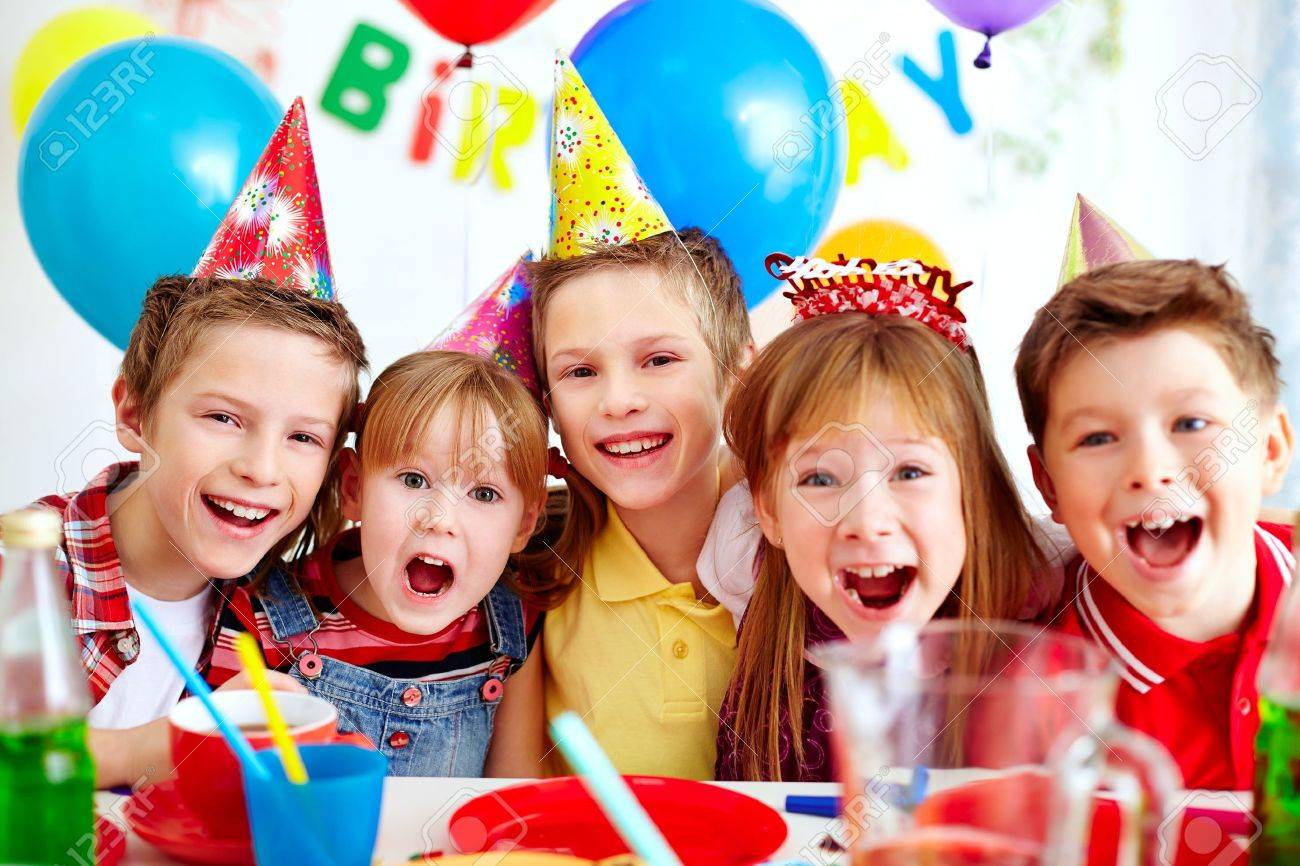 Group of adorable kids looking at camera at birthday party Stock Photo - 16333924