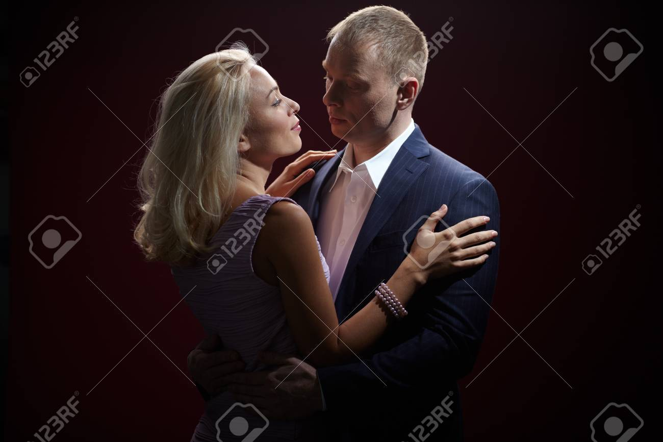 Two young dates looking at one another in darkness Stock Photo - 16607911
