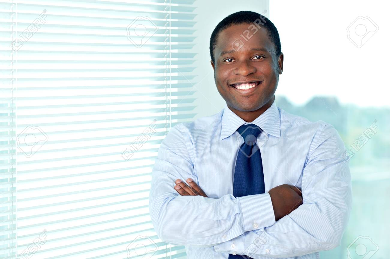 Portrait of African businessman looking at camera with smile Stock Photo - 16730295