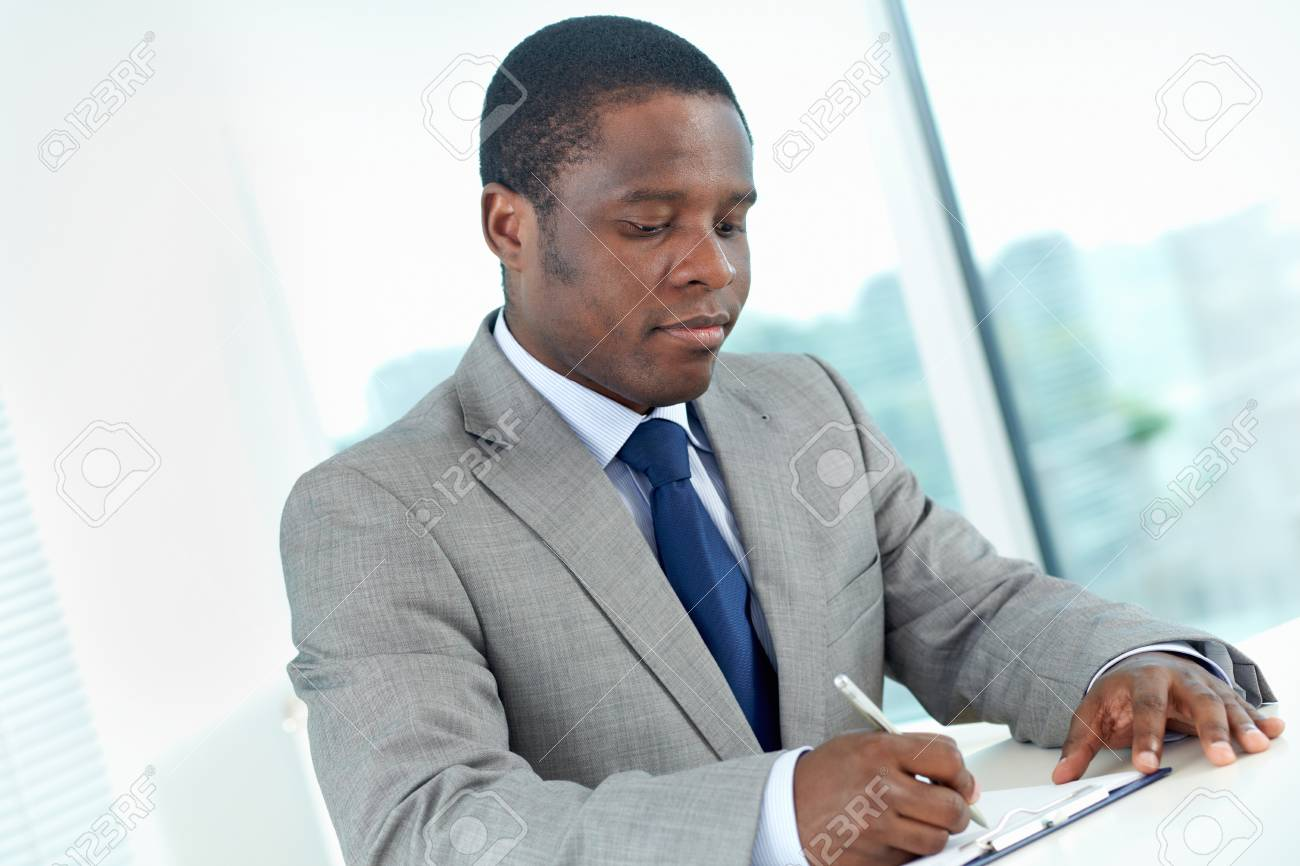 Portrait of confident African businessman working in office Stock Photo - 16730172