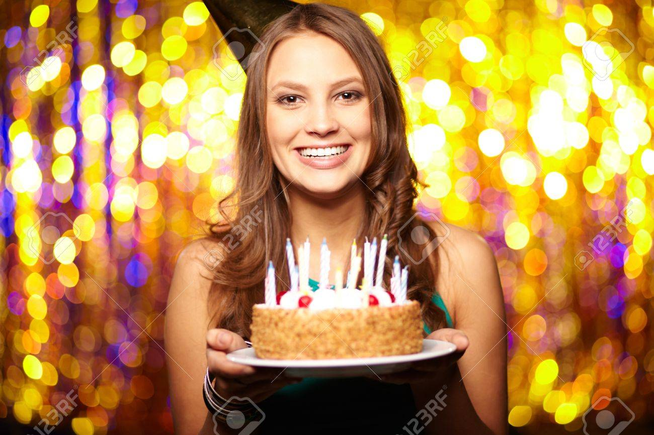 Portrait Of Joyful Girl Holding Birthday Cake And Looking At.. Stock Photo, Picture And Royalty Free Image. Image 16964063.