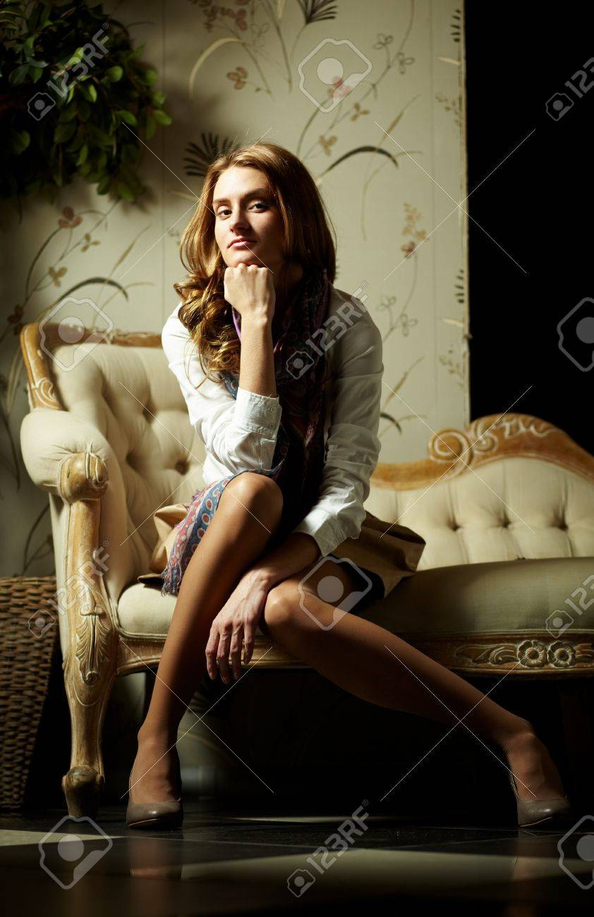 Image of elegant girl sitting in retro room and looking at camera Stock Photo - 17255277