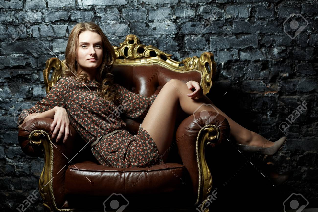 Image of elegant girl sitting in retro style armchair Stock Photo - 17255282
