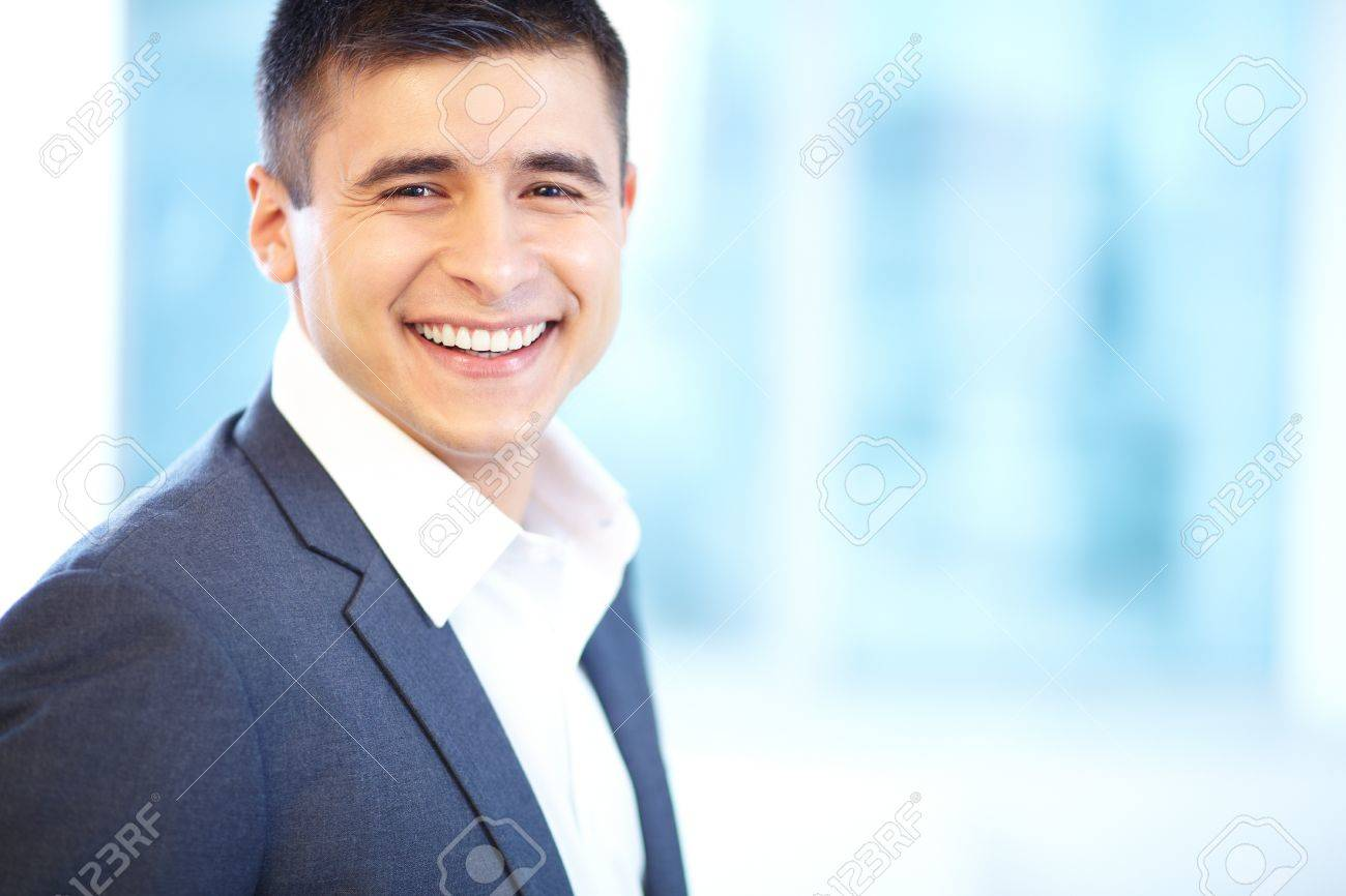 Portrait of cheerful businessman looking at camera with smile Stock Photo - 17340534