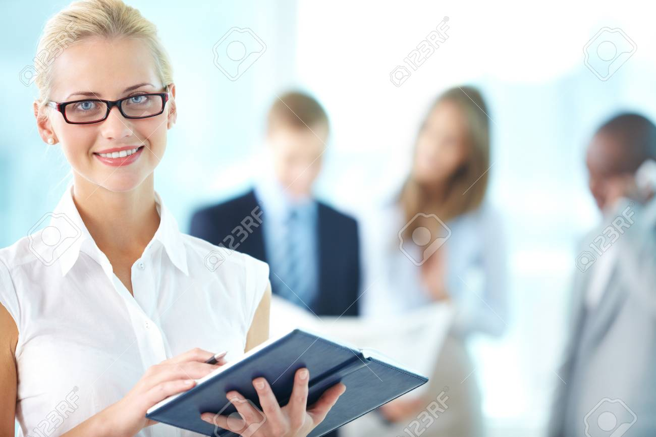 Cheerful young woman with an organizer being ready to take notes Stock Photo - 17359446