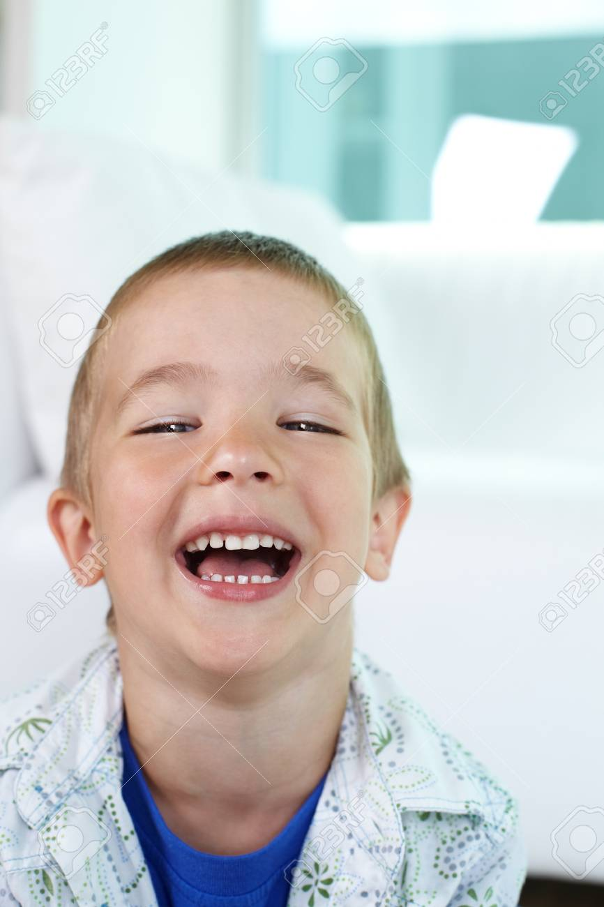 Portrait of happy little boy laughing and looking at camera Stock Photo - 17883688