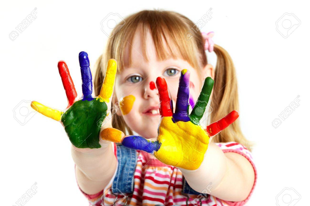 Girl having fun, her face and palms covered with paint Stock Photo - 18021590