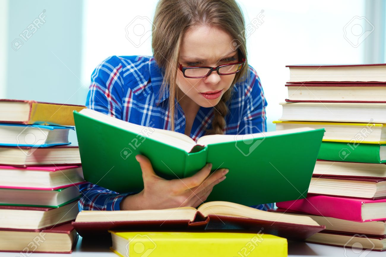 Diligent Student Being Absorbed In Studying Stock Photo, Picture And  Royalty Free Image. Image 18729948.