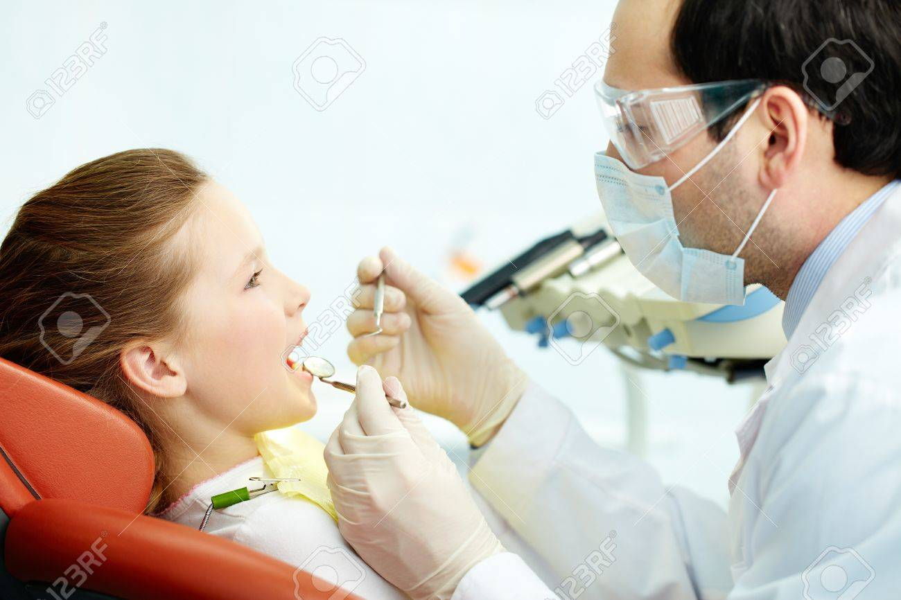 Side view of a dentist and his patient Stock Photo - 19096299