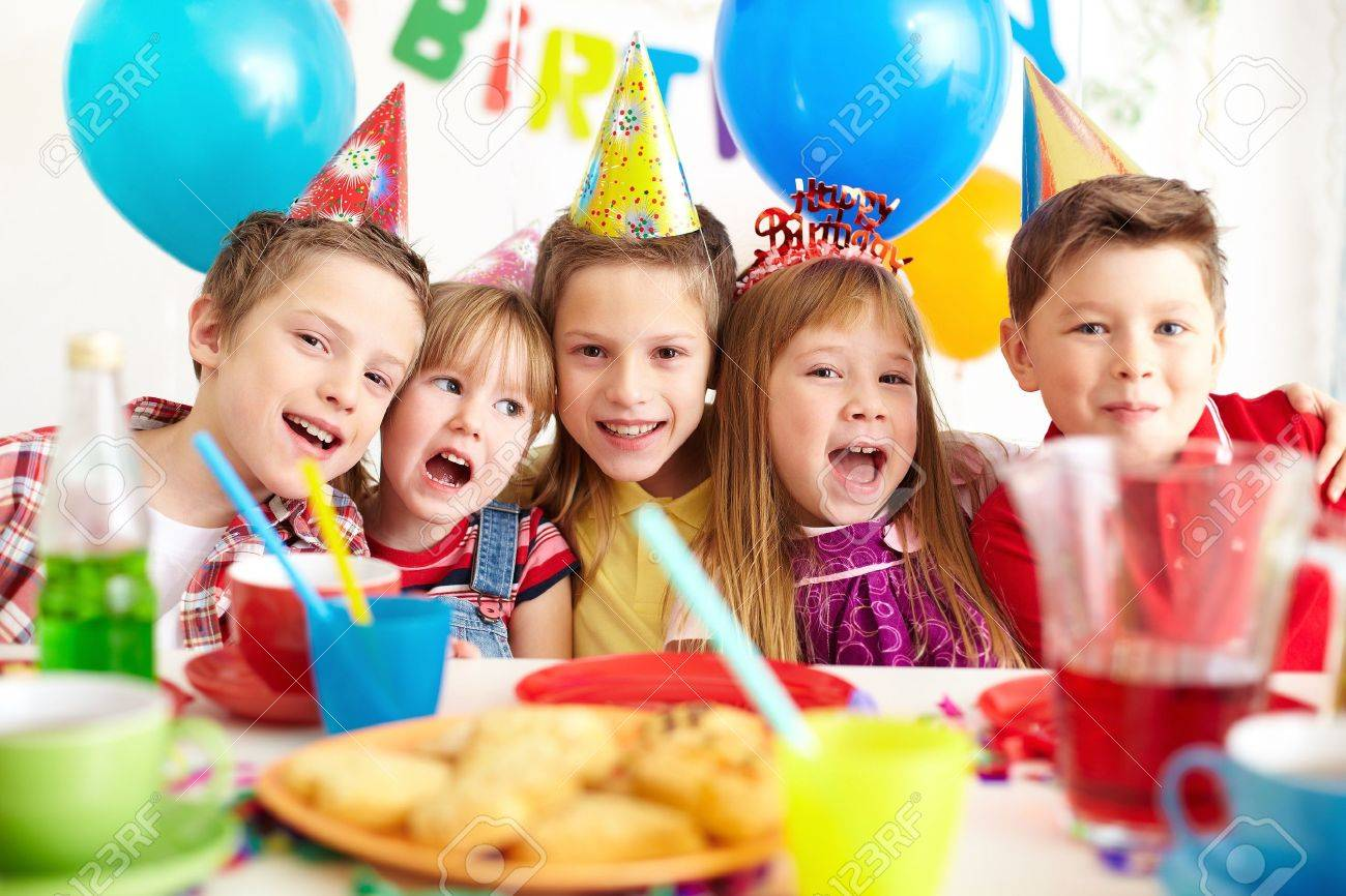 Group of adorable kids looking at camera at birthday party - 19146835