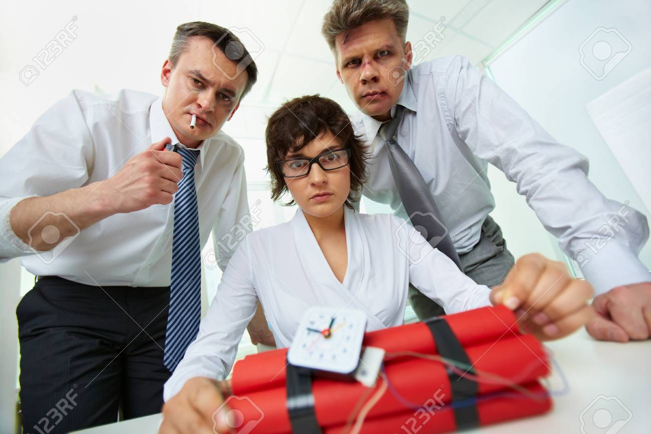 Group of businesspeople with dynamite looking at camera in office Stock Photo - 19170128