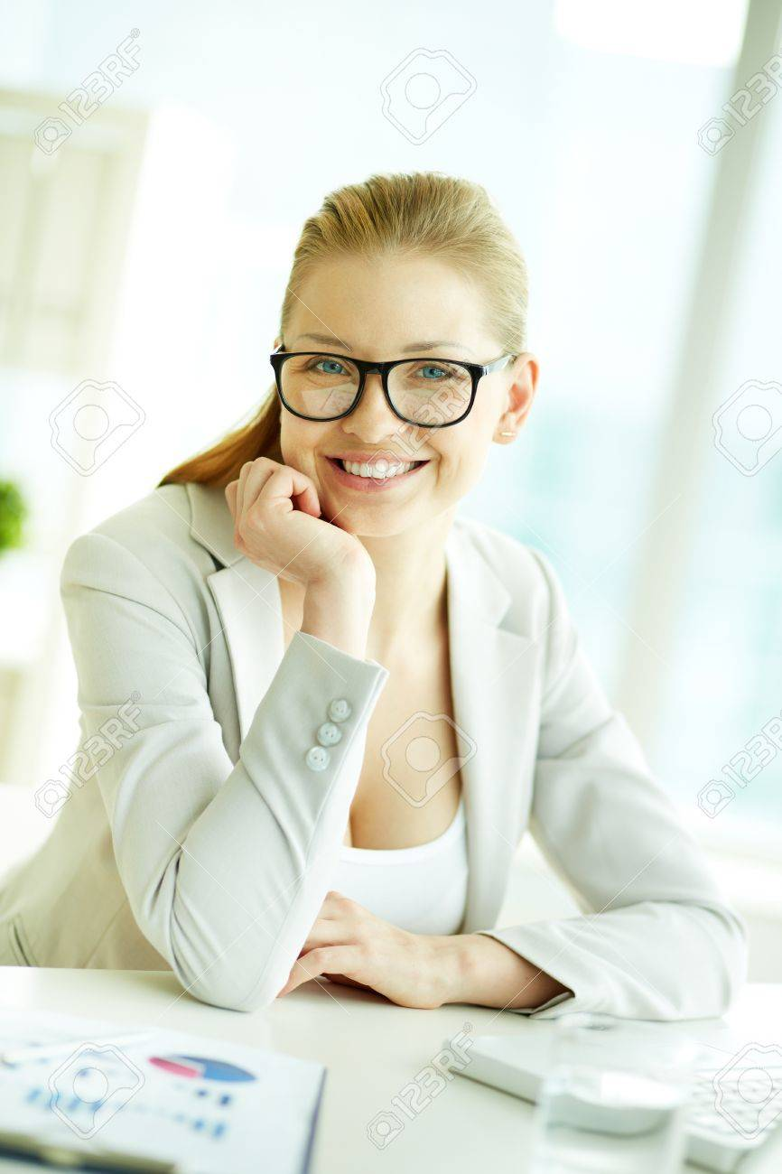 Portrait of successful businesswoman at workplace looking at camera Stock Photo - 19170115