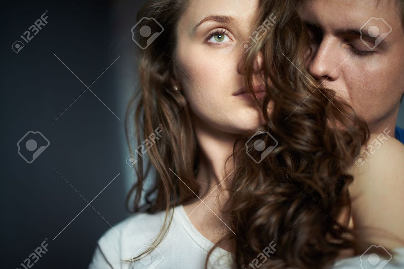 Young man enjoying smell of hair of his sweetheart Stock Photo - 20087955