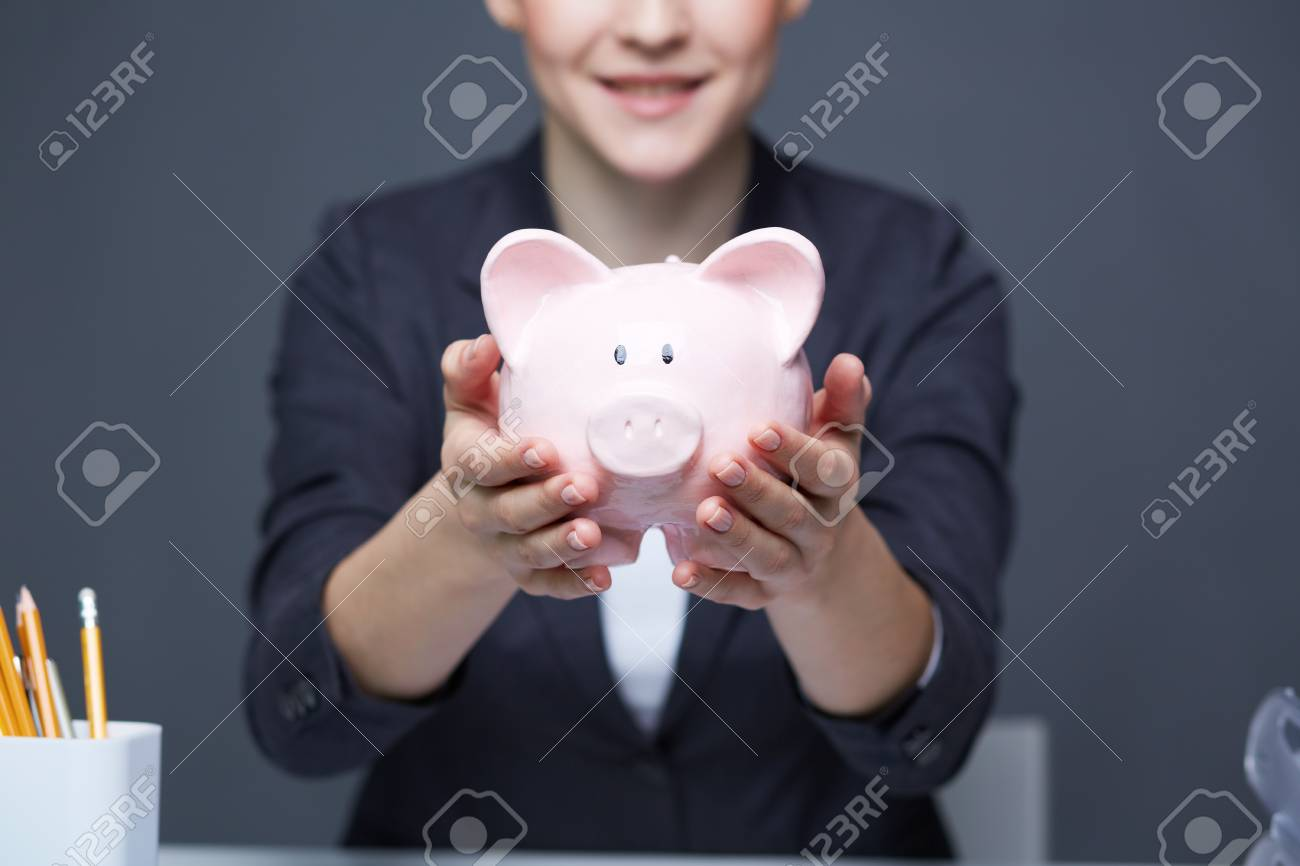 Image of pink piggy bank held by female Stock Photo - 20136816
