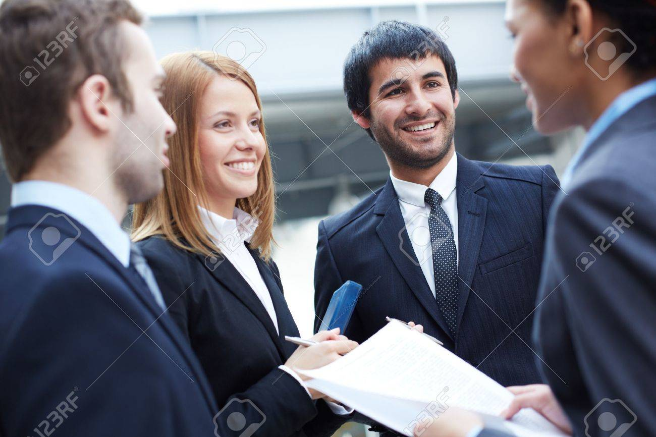 Group of business partners negotiating Stock Photo - 20137160