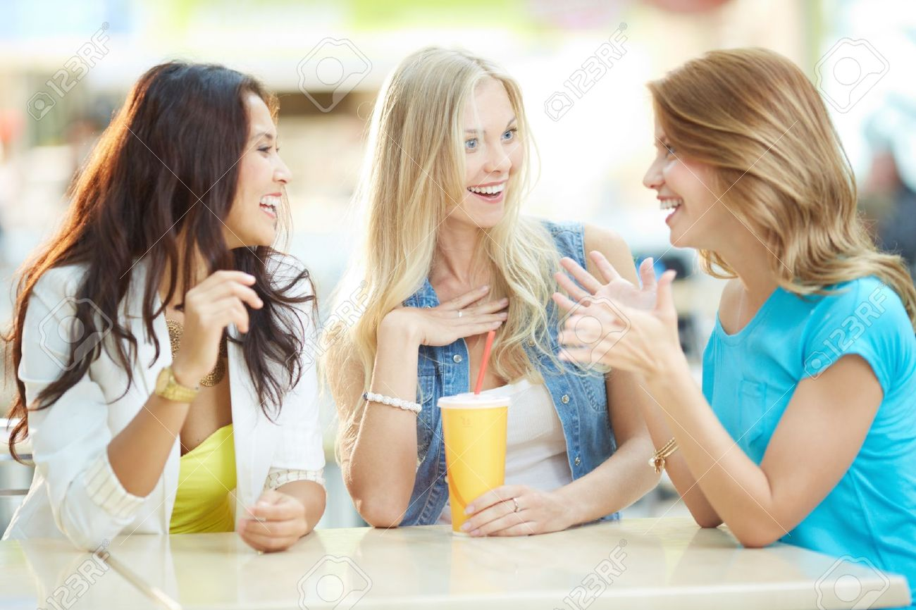 Portrait of three happy girls chatting while having drink after shopping Stock Photo - 20137152