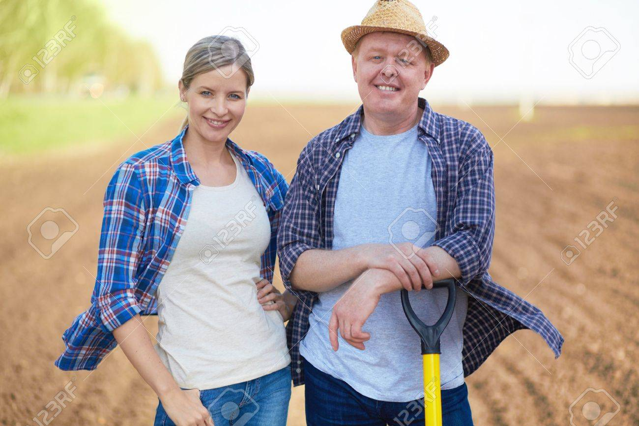 Image of two happy farmers on background of plowed field Stock Photo - 20137178